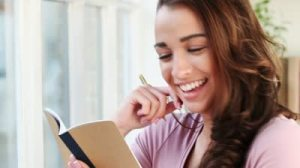stock-footage-happy-young-student-studying-at-home-and-smiling-is-joyful