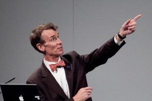 Bill Nye pointing upwards