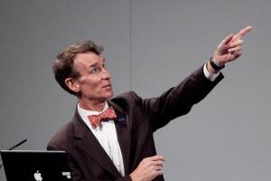 Bill Nye pointing upwards