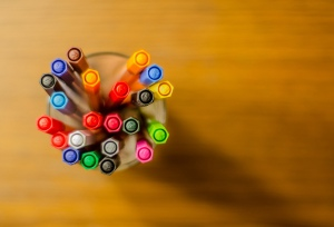 A cup of colorful pens