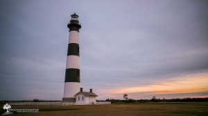 Black and white Bodie Island Lighthouse during a sunset.