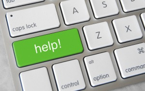 """green """"help!"""" button on a white keyboard"""