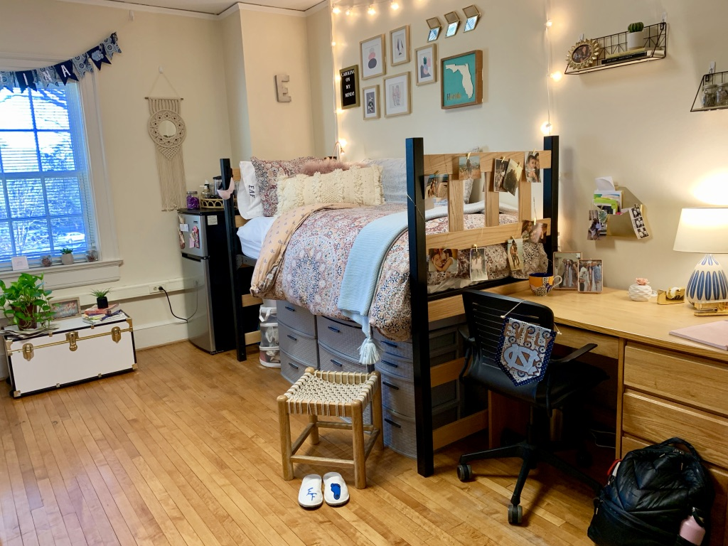 Room in residence hall with Carolina gear and calming touches